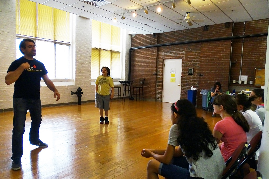 Teaching Artist John Gregorio with the Young Company middle school group